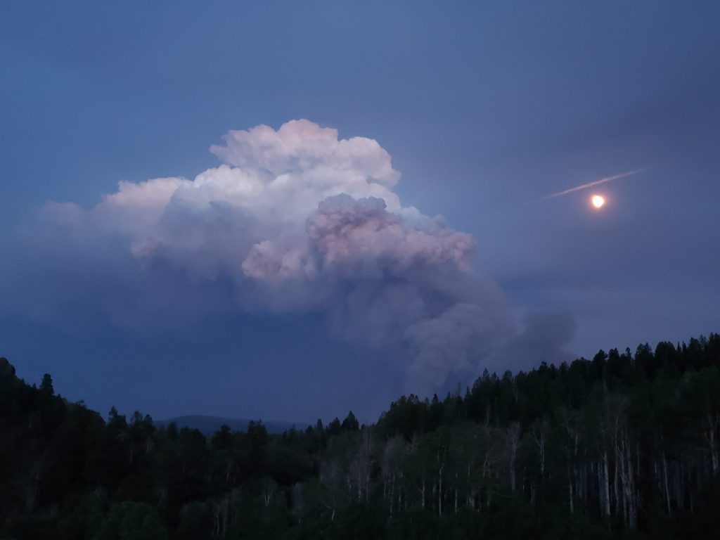 Photo taken Tuesday (6/22) night just after 9:00 from my house located about 1.7 miles south of Stagecoach Reservoir.  Moon and pyrocumulus cloud above Muddy Slide fire.