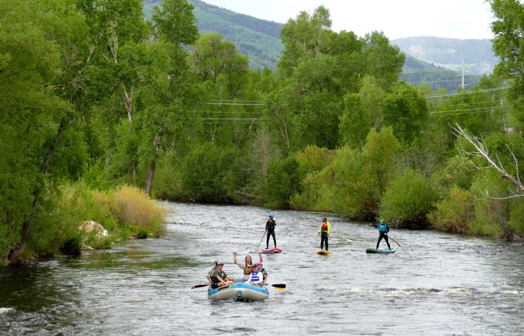 It is such a hot day in Steamboat that everyone is playing on the river today. Here are a few happy pictures of rafters, kayakers, and paddleboarders, enjoying our wonderful Yampa River that flows through downtown Steamboat Springs.