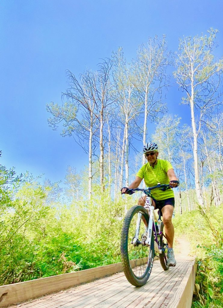 Riding Mt. Bikes on a Bluebird Day on Flash of Gold Trail.