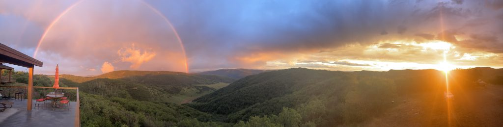 Double rainbow, smoke and a sunset This picture was taken on August 3rd from Canyon Valley Ranch, Steamboat Springs
