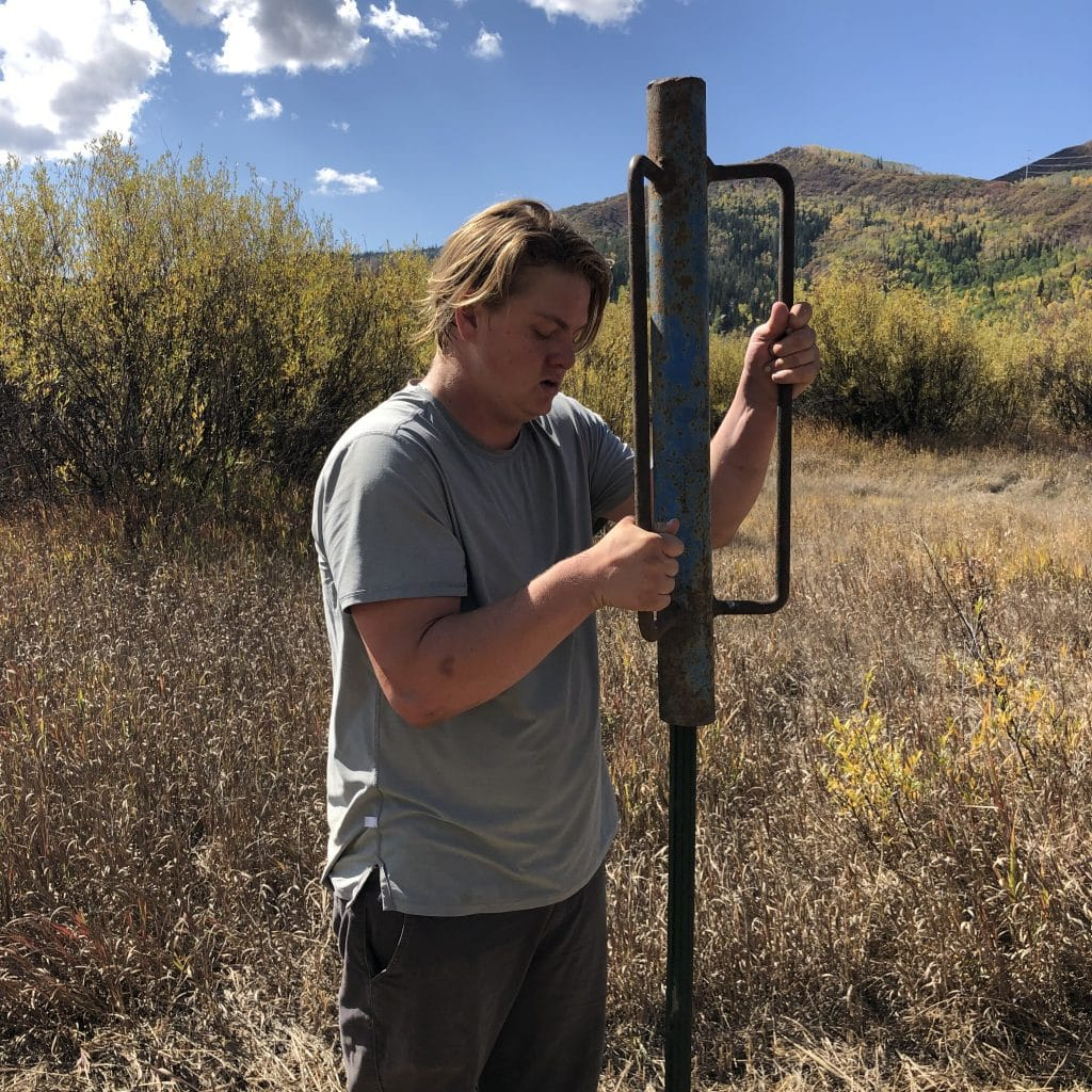 Otis Van De Carr, with the Friends of the Yampa, pounding posts for fencing to protect newly planted cottonwood trees on the floodplain of the Yampa River.